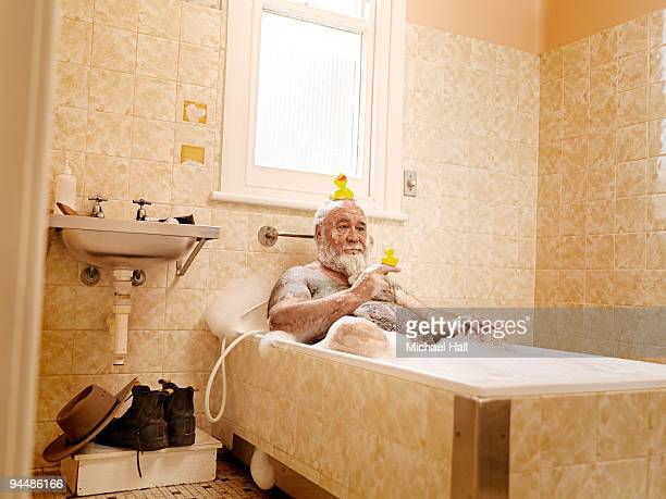 Man in bath with rubber ducky