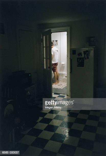 Man in Bathroom at Night