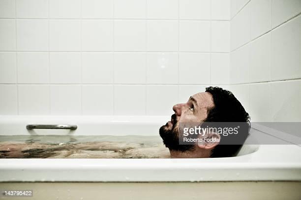 Man in bathtub