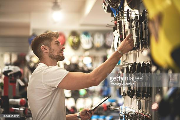 man in bicycle store - sports equipment stock pictures, royalty-free photos & images