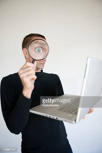 Man in Black Invading Privacy with Magnifying Glass