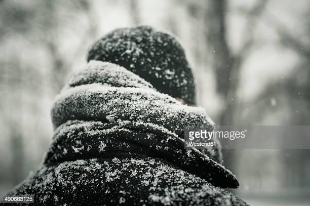 man in black jacket in snow, close-up - coat stock-fotos und bilder