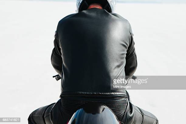 Man in black leather, sitting on motorcycle and preparing to race on Bonneville Salt Flats, UT