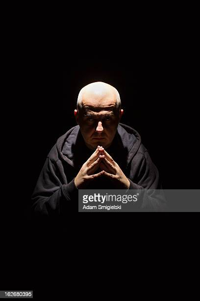 man in black - evil stock photos and pictures