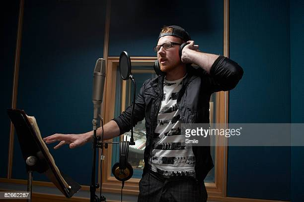 man in black singing in recording studio