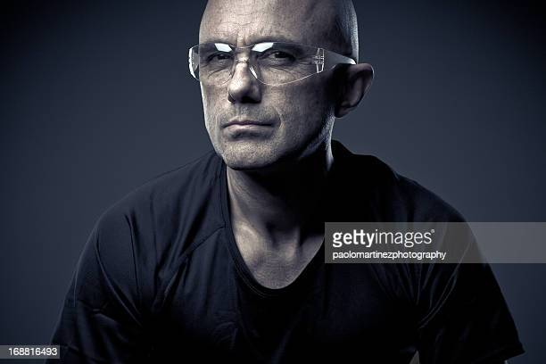 man in black t-shirt with transparent glasses