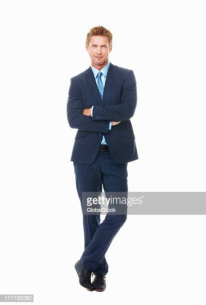 Man in blue suit and tie with arms folded and legs crossed