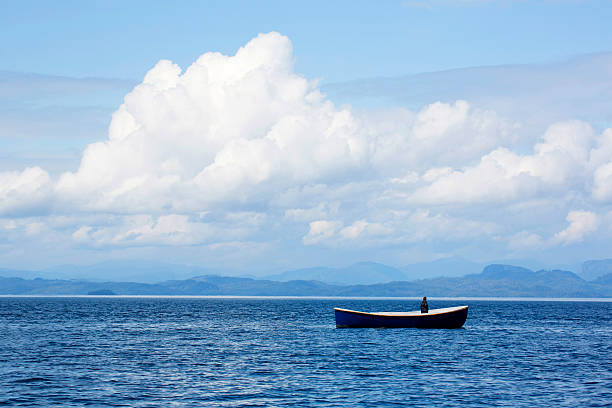 Man In Boat Adrift