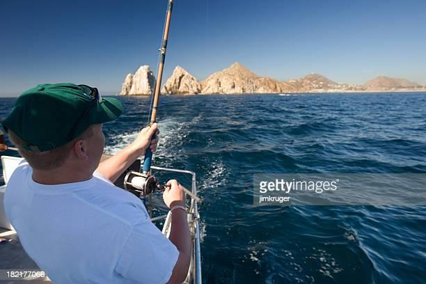 Man in boat deep sea fishing, Cabo San Lucas.