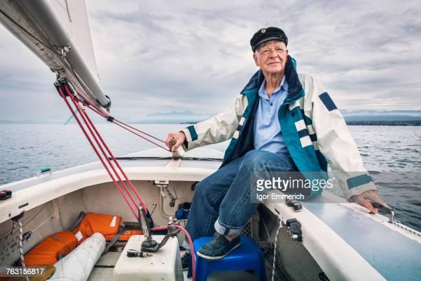 man in boat on lake leman, geneva, switzerland - wasserfahrzeug stock-fotos und bilder