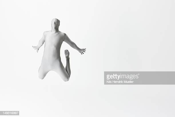 Man in bodysuit jumping