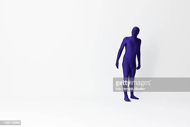 man in bodysuit looking up - bodysuit stock pictures, royalty-free photos & images