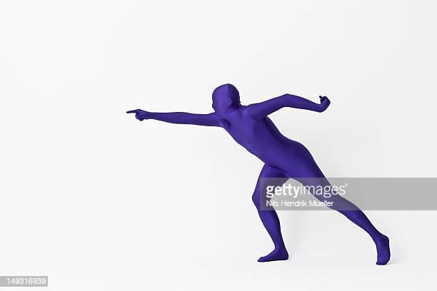 Man in bodysuit pointing