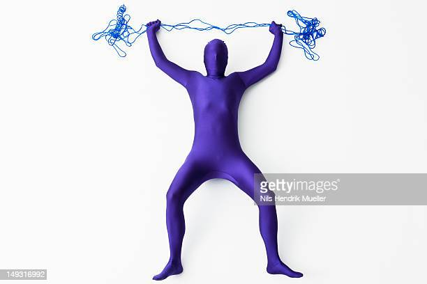 Man in bodysuit posing with string