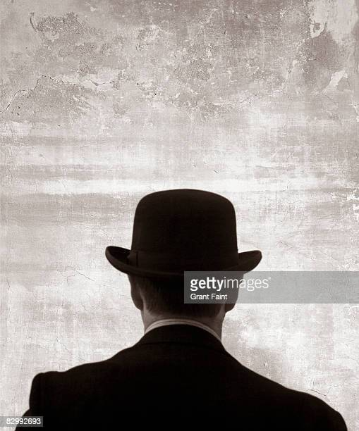 man in bowler hat rear  view