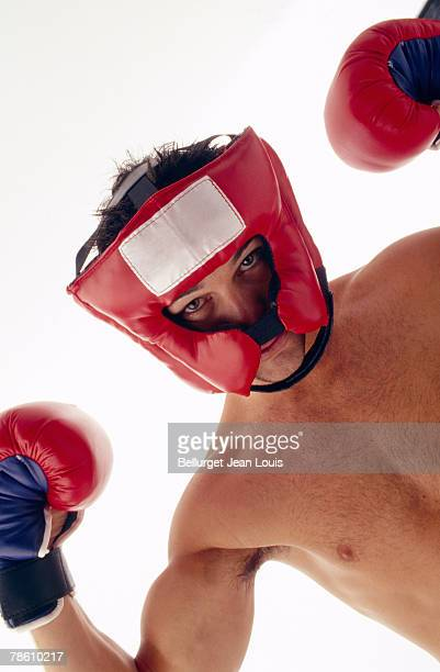 Man in boxing gloves and helmet