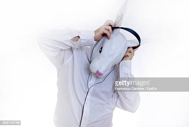 Man In Bunny Face Wearing Head Phones Against White Background