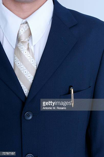 Man in business suit, mid section, close up