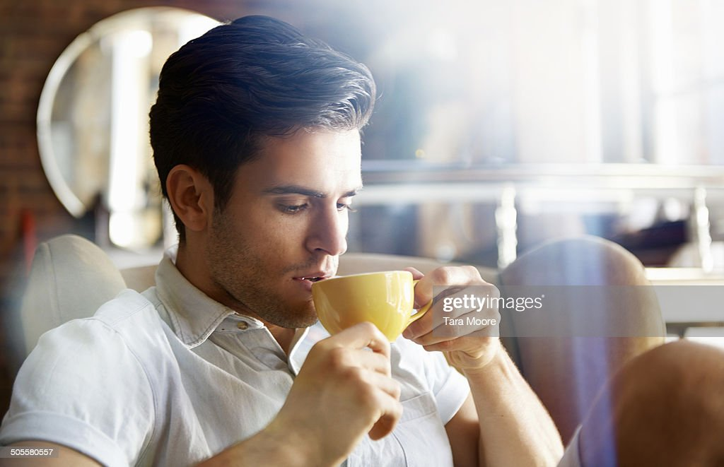 man in cafe drinking coffee : Stock Photo