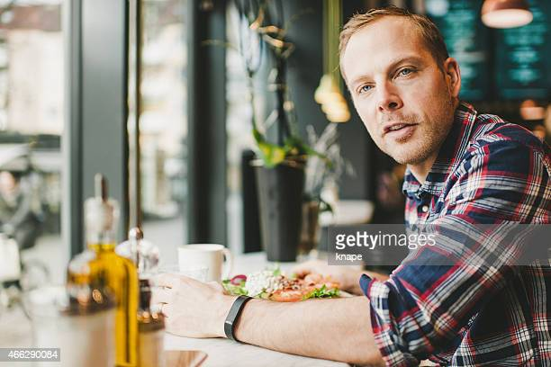 Man in cafe restaurant eating lunch.