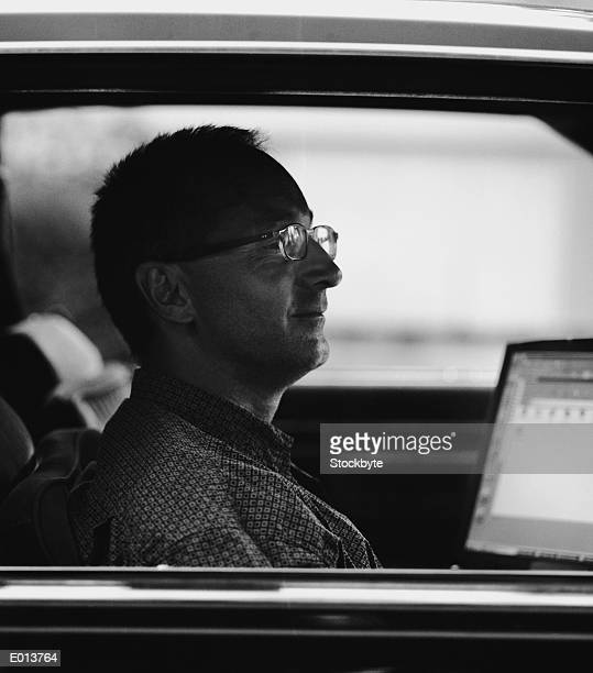 Man in Car with Open Laptop
