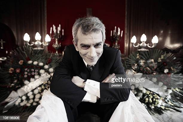 man in casket sitting up and smiling - coffin stock pictures, royalty-free photos & images
