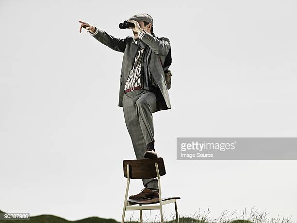 Man in chair with binoculars
