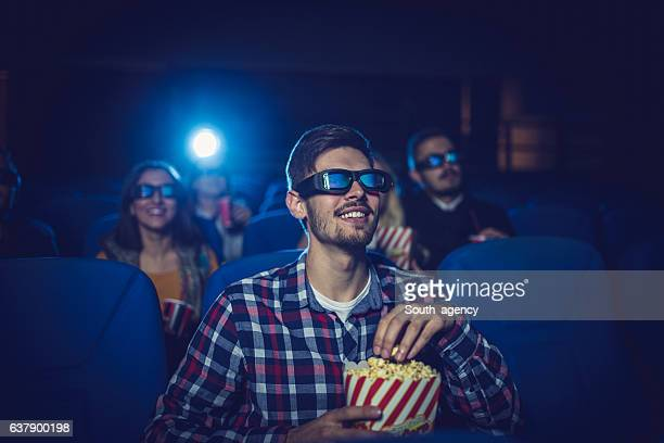 man in cinema - blue film video stock photos and pictures