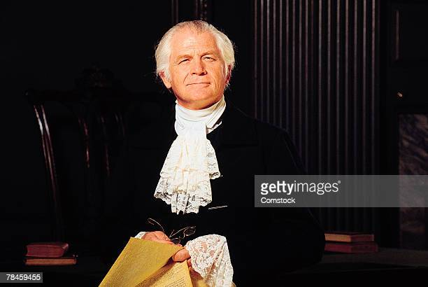 man in colonial attire , independence hall , philadelphia , pennsylvania - colonial america stock photos and pictures