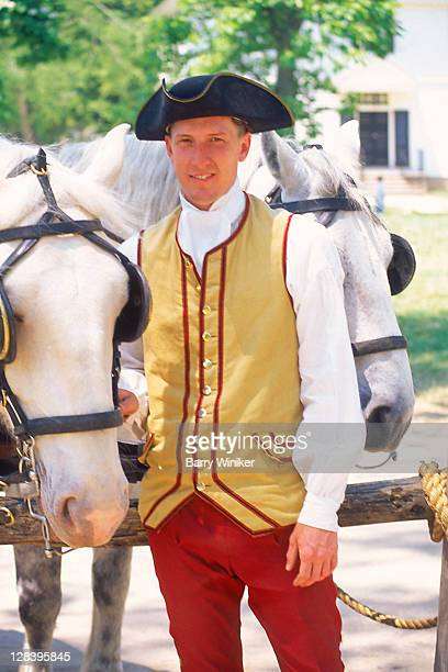 man in colonial williamsburg attire - williamsburg virginia stock pictures, royalty-free photos & images