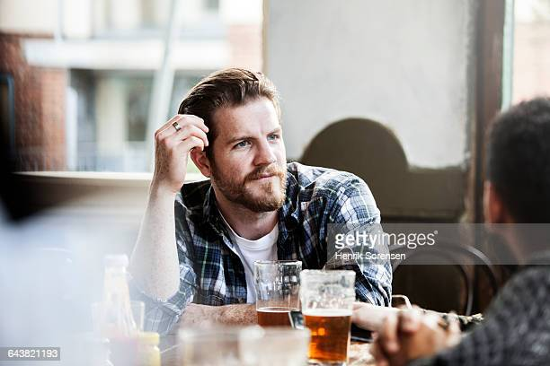 Man in conversation in a pub