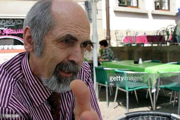 Man in conversation