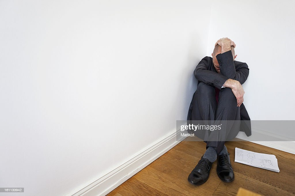 Man in corner : Stock Photo