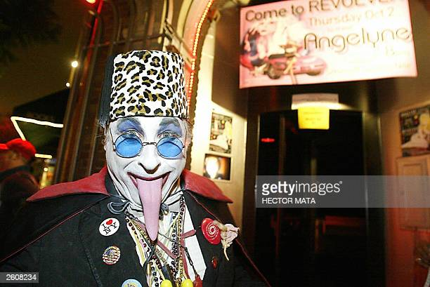 A man in costume poses as he waits in a queue to meet Gubernatorial candidate Angelyne the 'Hollywood Billboard Queen' at a bar in West Hollywood 02...