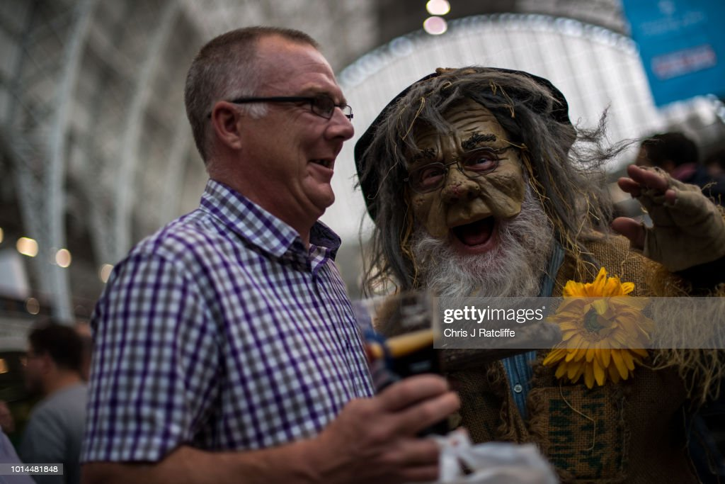 A man in costume walks amongst beer enthusiasts during the Great British Beer Festival at Olympia Exhibition Centre on August 10, 2018 in London, England. The five day festival showcases over 900 real ales and craft beer and is organised by Campaign for Real Ale group CAMRA.