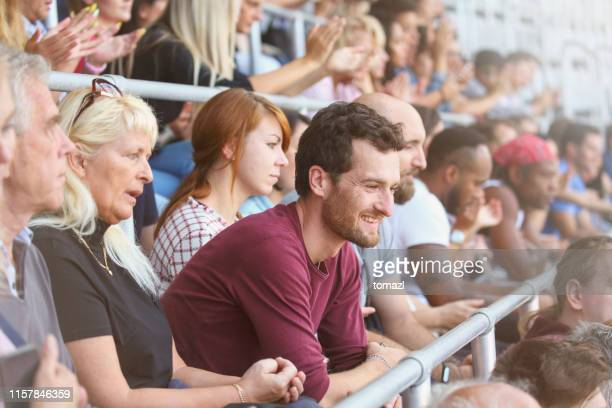 man in crowds on stadium - bleachers stock pictures, royalty-free photos & images