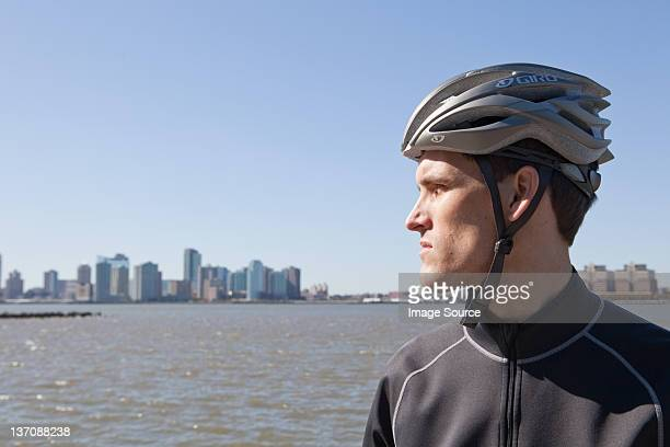 man in cycling gear looking at view - cycling helmet stock photos and pictures