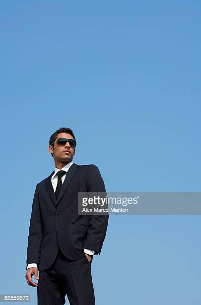man in dark suit, dark glasses