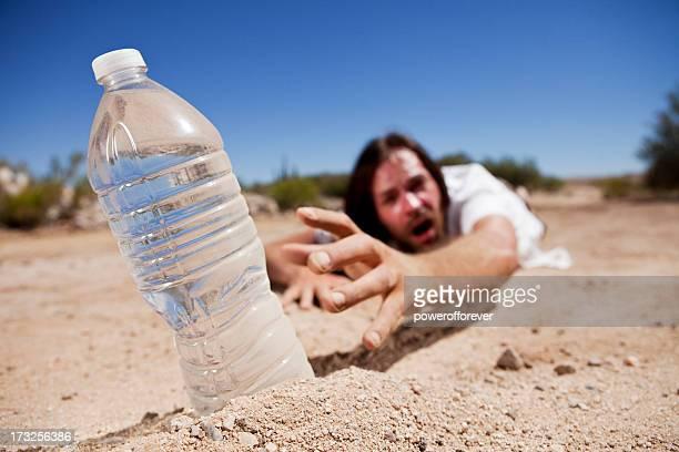 Man in Desert Reaching for Water