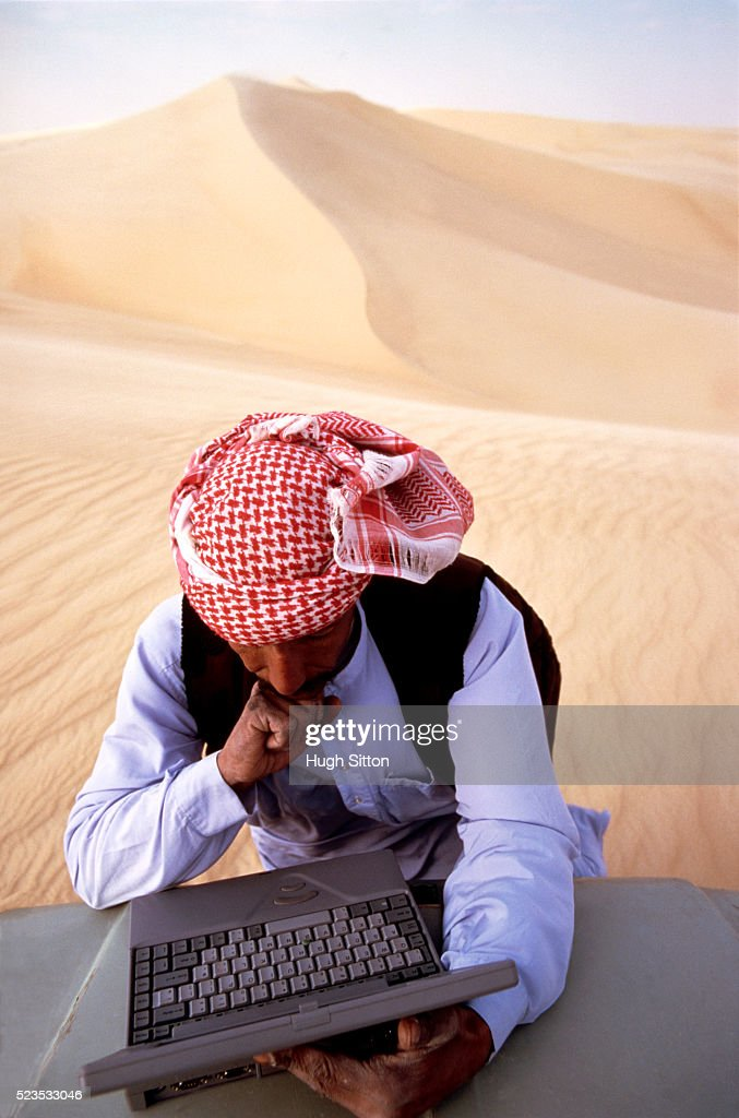 Man in Desert with a Laptop : Stock Photo