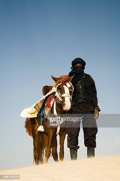 Man in Desert with Horse