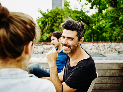 Man in discussion with friend during party - gettyimageskorea