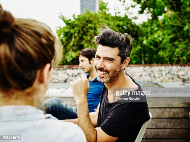 Man in discussion with friend during party