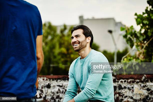 Man in discussion with friends during party
