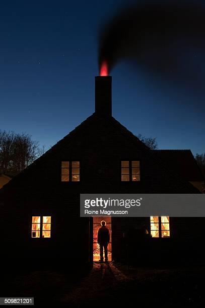 Man in door, house