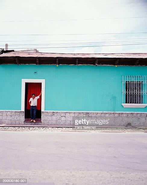 man in doorway of brothel - 売春宿 ストックフォトと画像