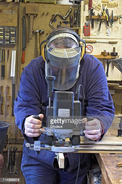 man in dust mask routing - helmet visor stock pictures, royalty-free photos & images