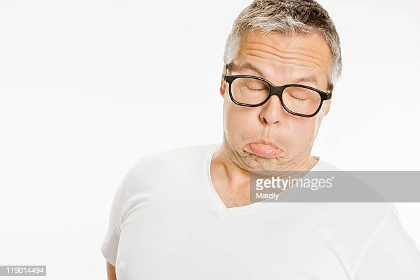 man in eyeglasses making a funny face - grimacing stock pictures, royalty-free photos & images
