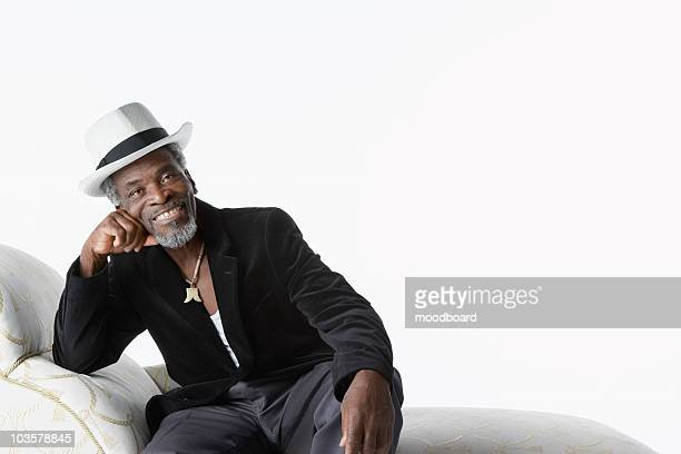 Man in Fedora on Chaise Lounge