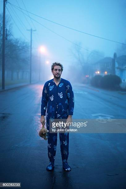 Man in footed pajamas on a foggy morning